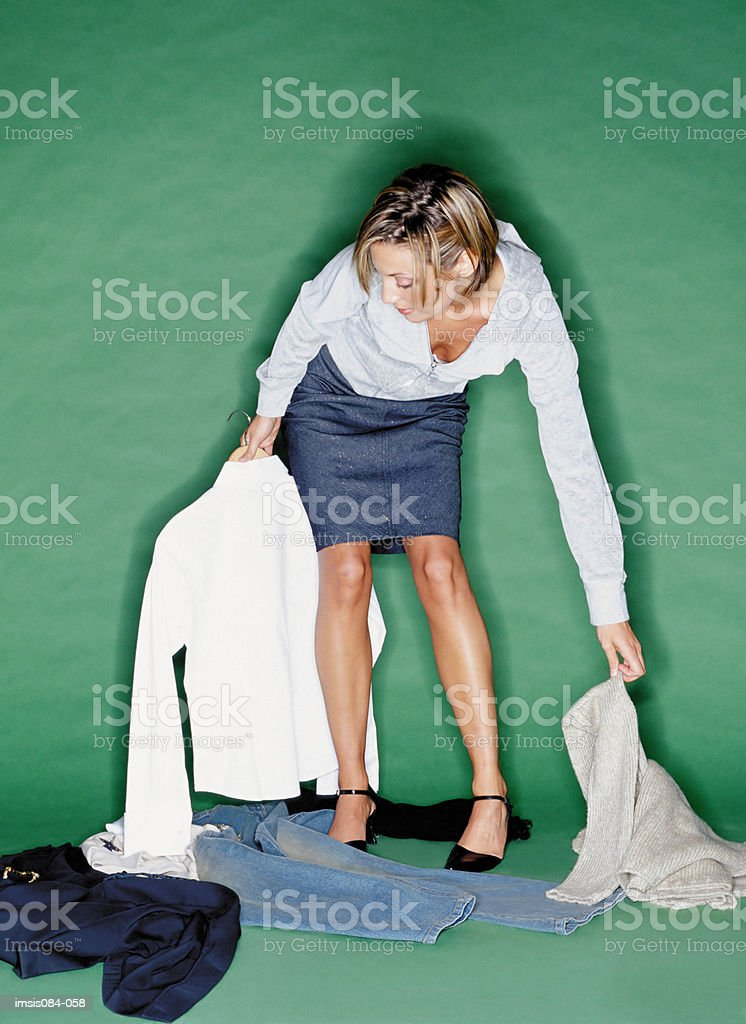 Woman trying on clothes royalty-free 스톡 사진