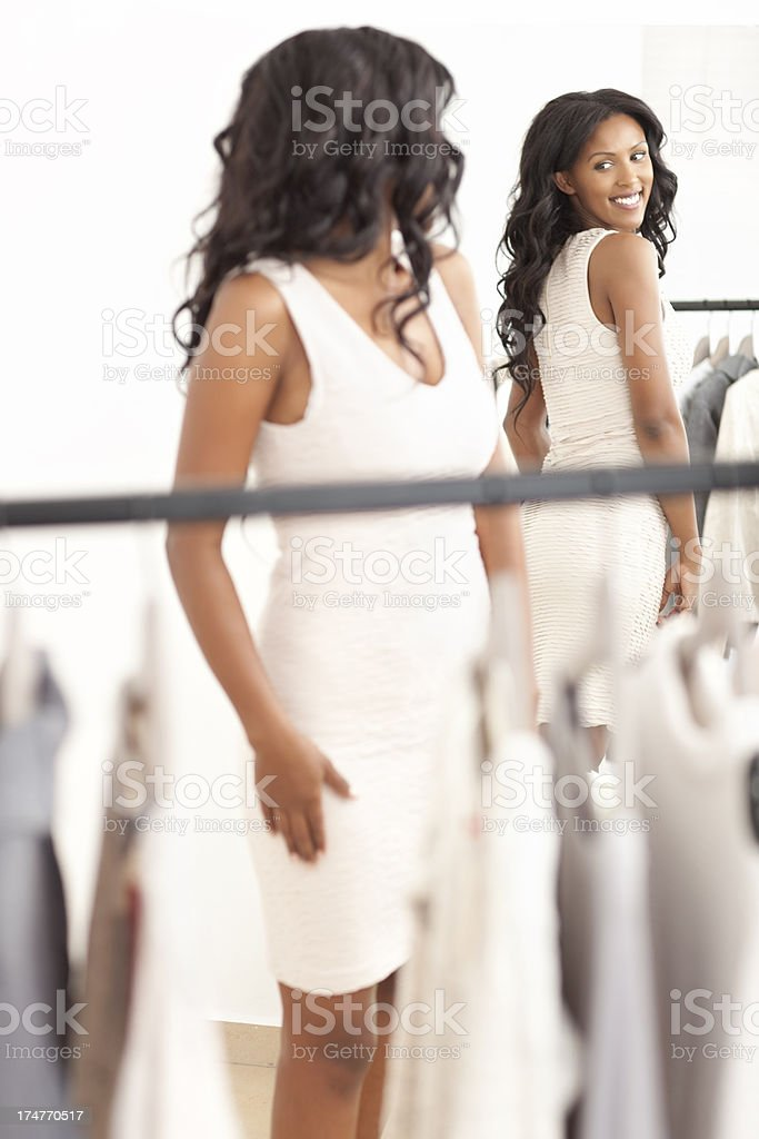 Woman trying on dress. stock photo