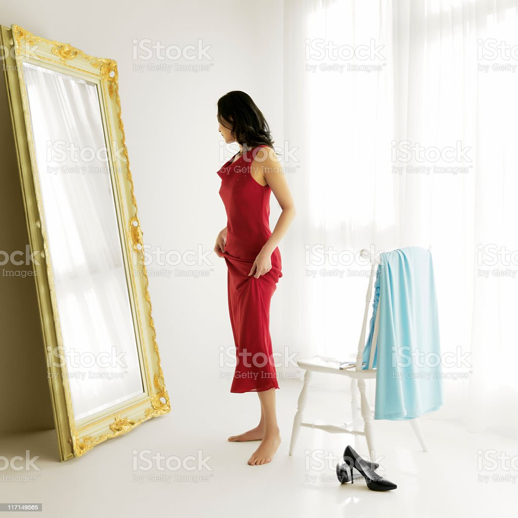 Woman Trying on Evening Gowns stock photo