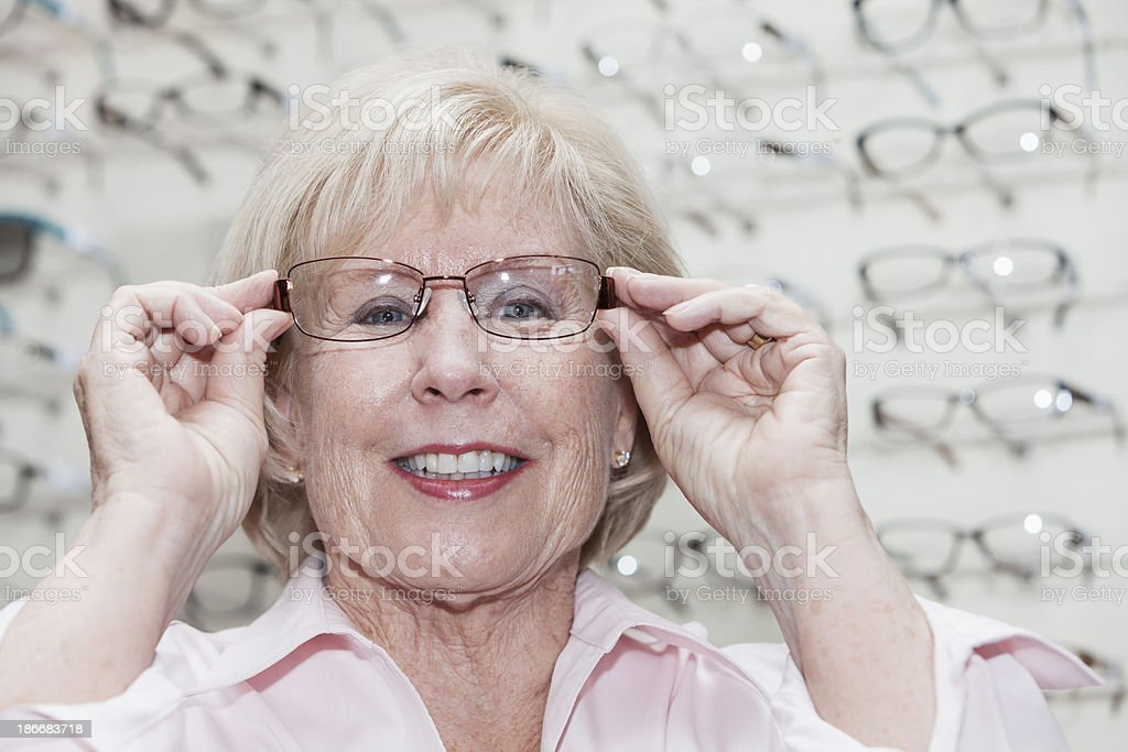Woman trying on eyeglasses royalty-free stock photo