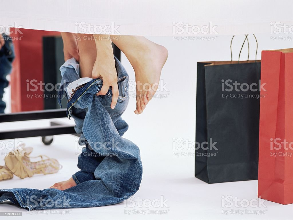 Woman trying on jeans royalty-free stock photo