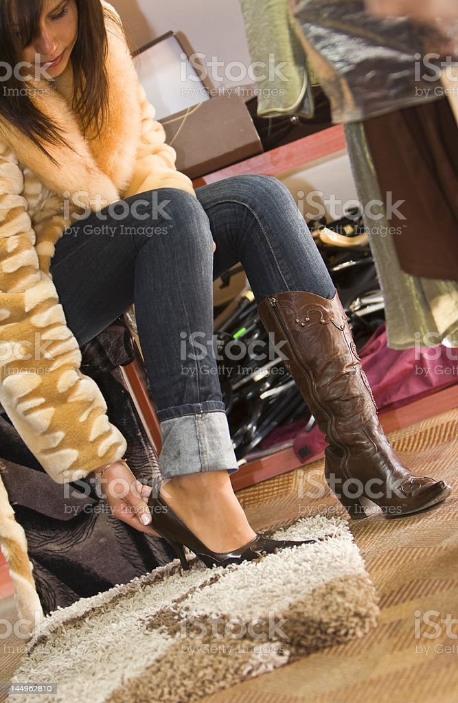 Woman trying on new shoes royalty-free stock photo