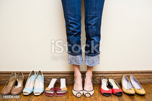 istock Woman Trying on Shoes 183336164
