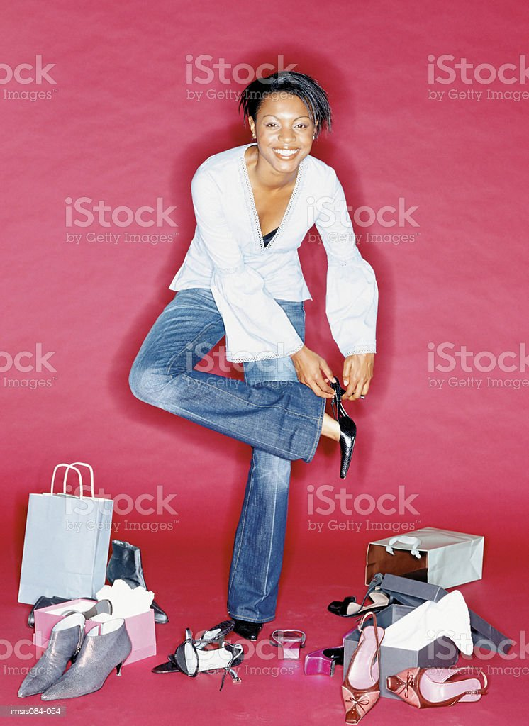 Woman trying on shoes royalty-free stock photo