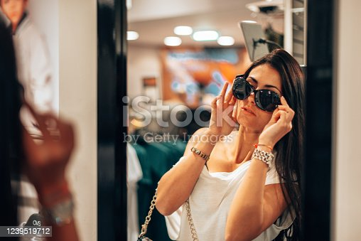 woman trying sunglasses at the store