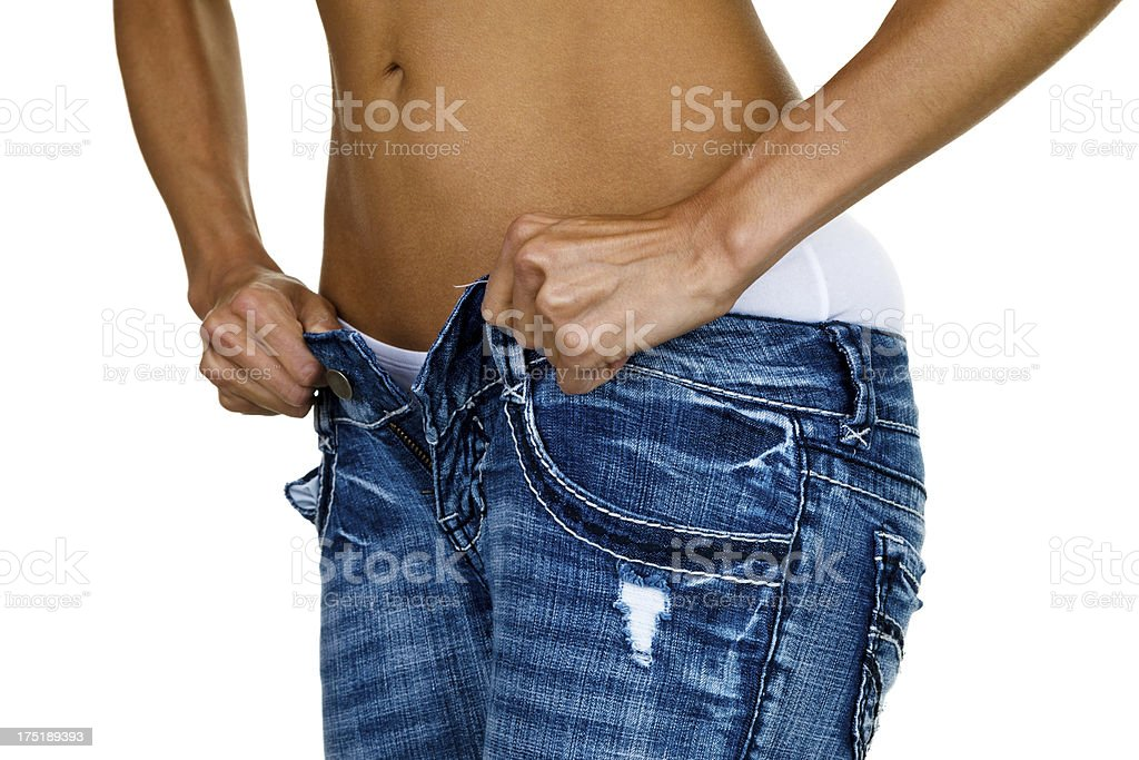 Woman trying to button tight jeans royalty-free stock photo