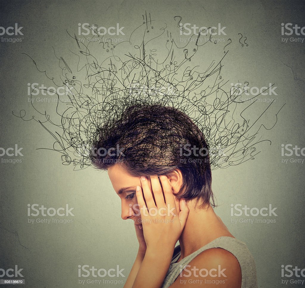 woman trying to concentrate brain melting into lines stock photo
