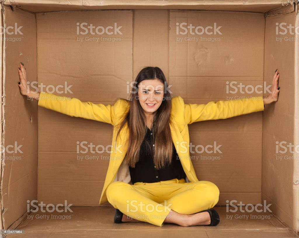 woman trying to enlarge the office space stock photo