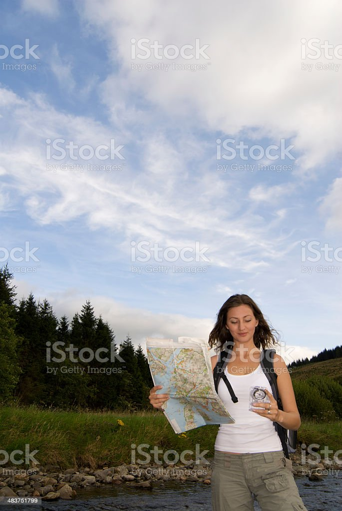 Woman trying to find her way royalty-free stock photo