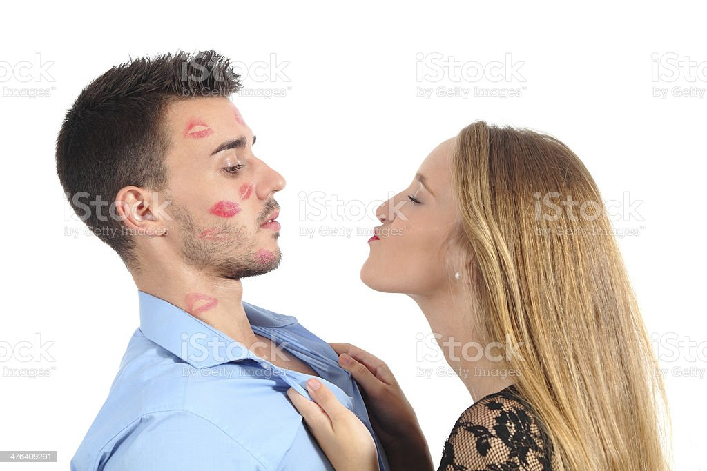 Woman trying to kiss a man desperately stock photo