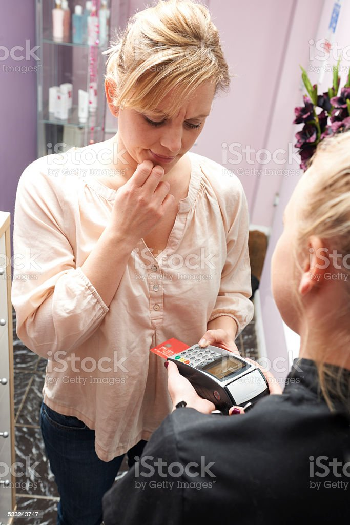 Woman Trying To Remember Security Details For Credit Card Paymen stock photo