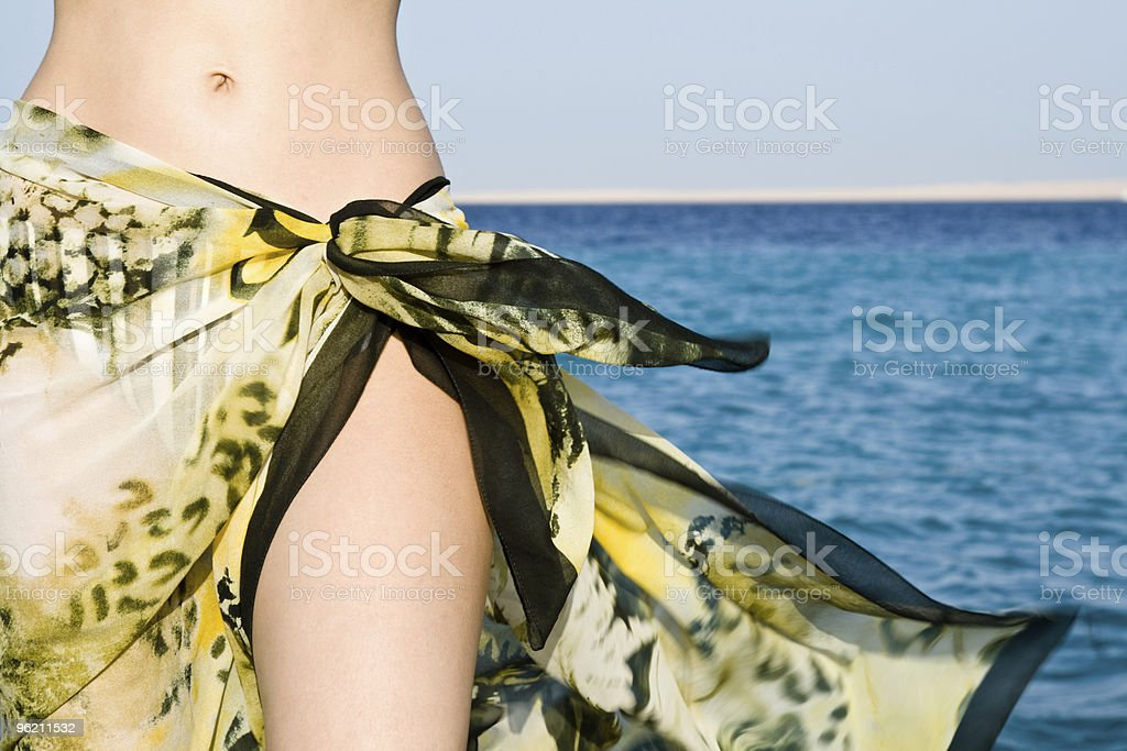 Woman tummy in shawl royalty-free stock photo