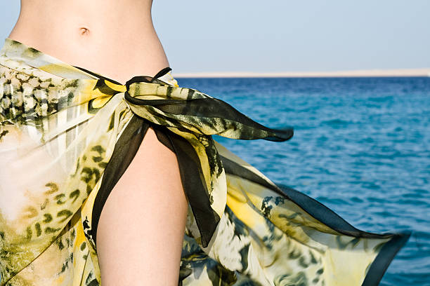 Woman tummy in shawl stock photo
