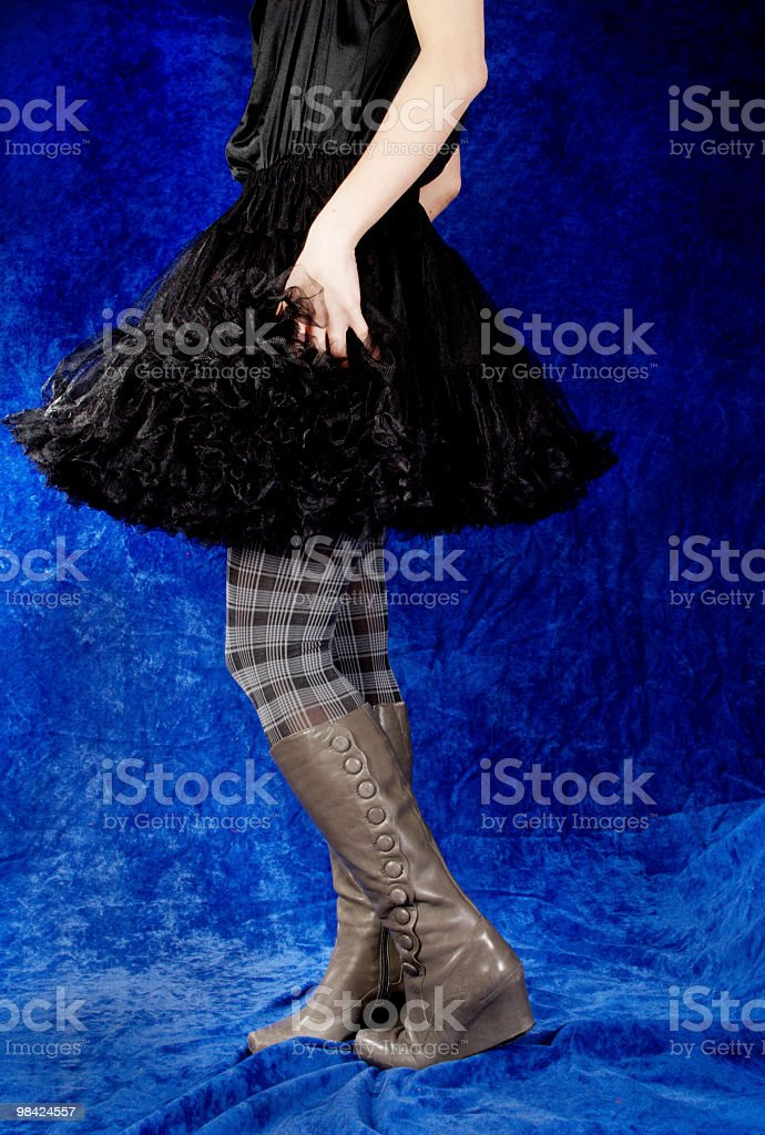 Woman turning in black crinoline. royalty-free stock photo
