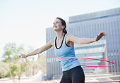 Woman twirling hula hoops