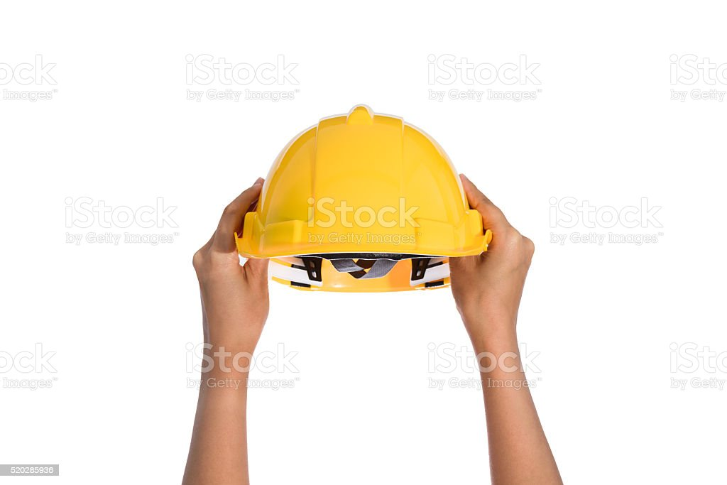 Woman two hand holding a hardhat, helmet isolated stock photo