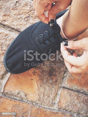 Woman tying running shoe laces