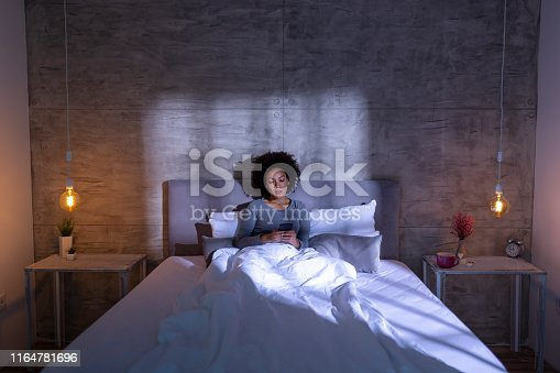 istock Woman typing a text message on a smartphone 1164781696