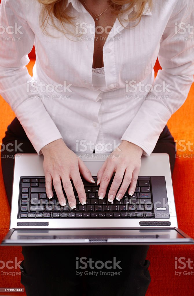 Woman typing on a laptop royalty-free stock photo