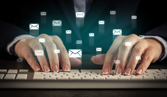 istock Woman typing on keyboard with chat icons around 1178101291