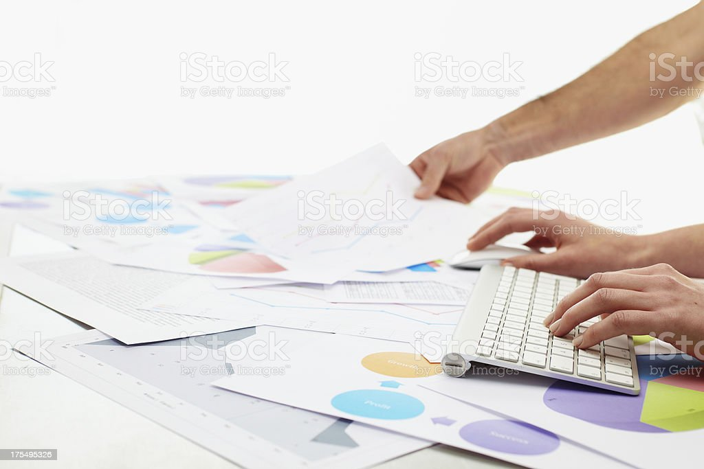Woman typing on keybord with charts around her royalty-free stock photo
