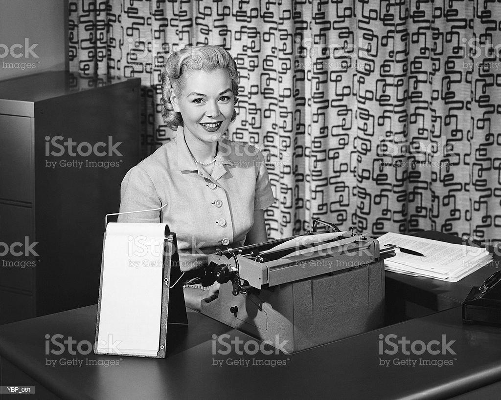 Woman typing, smiling and posing royalty free stockfoto