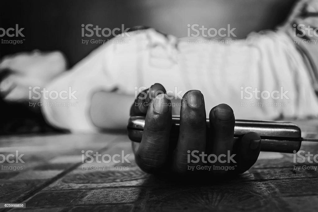 woman unconscious falling on ground stock photo