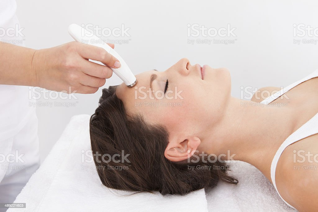 Woman Under Going Microdermabrasion Treatment stock photo