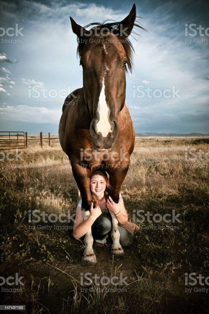 Woman Under Horse stock photo