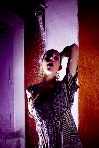 Woman Under Splash Water Stock Photo - Download Image Now