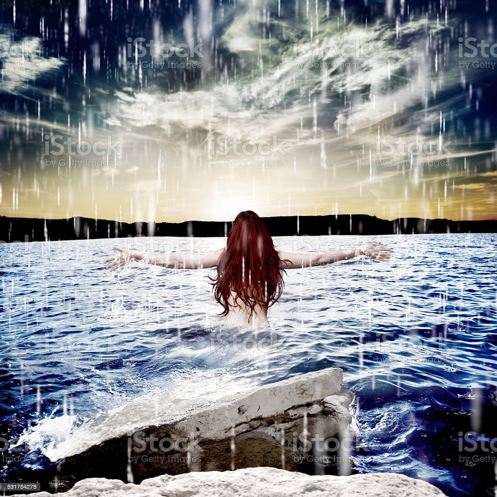 Woman under storm at sea.Freedom stock photo