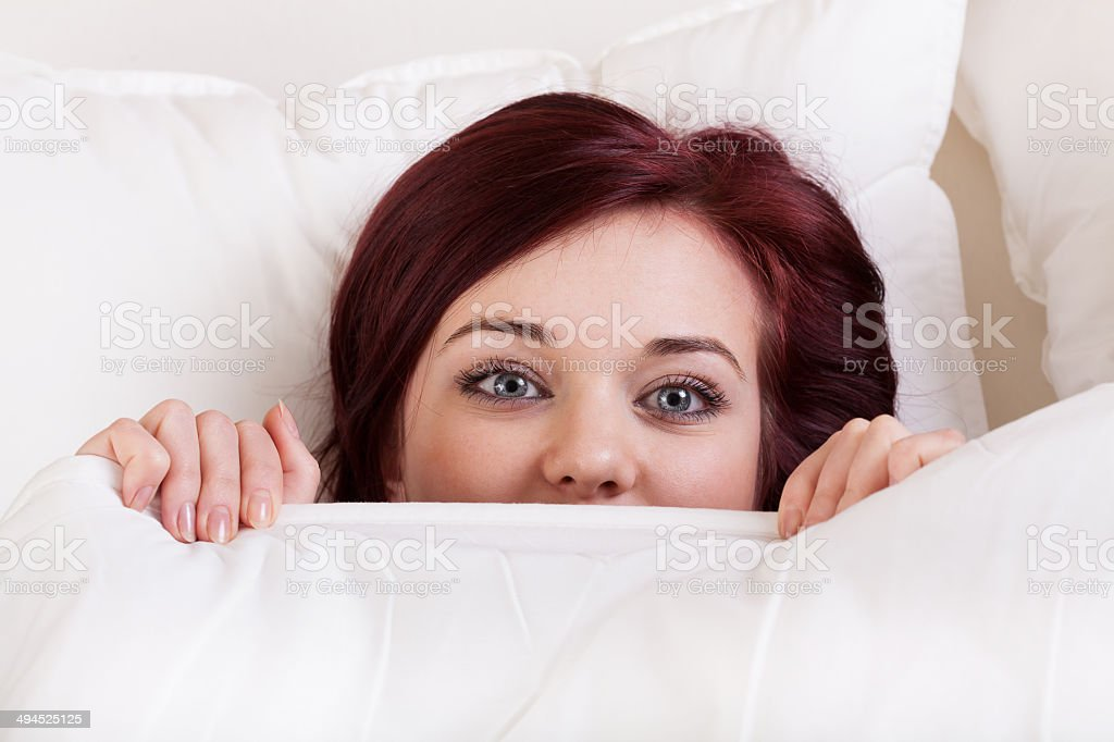 Woman under the sheet stock photo