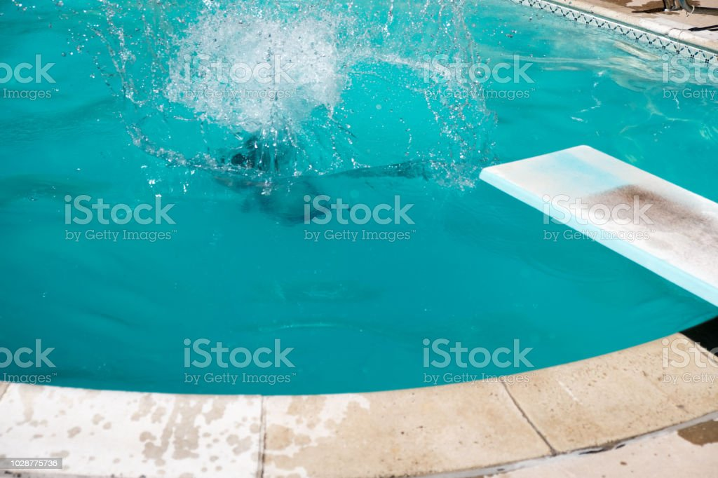 Woman Under Water After Jumping Off Diving Board In An ...