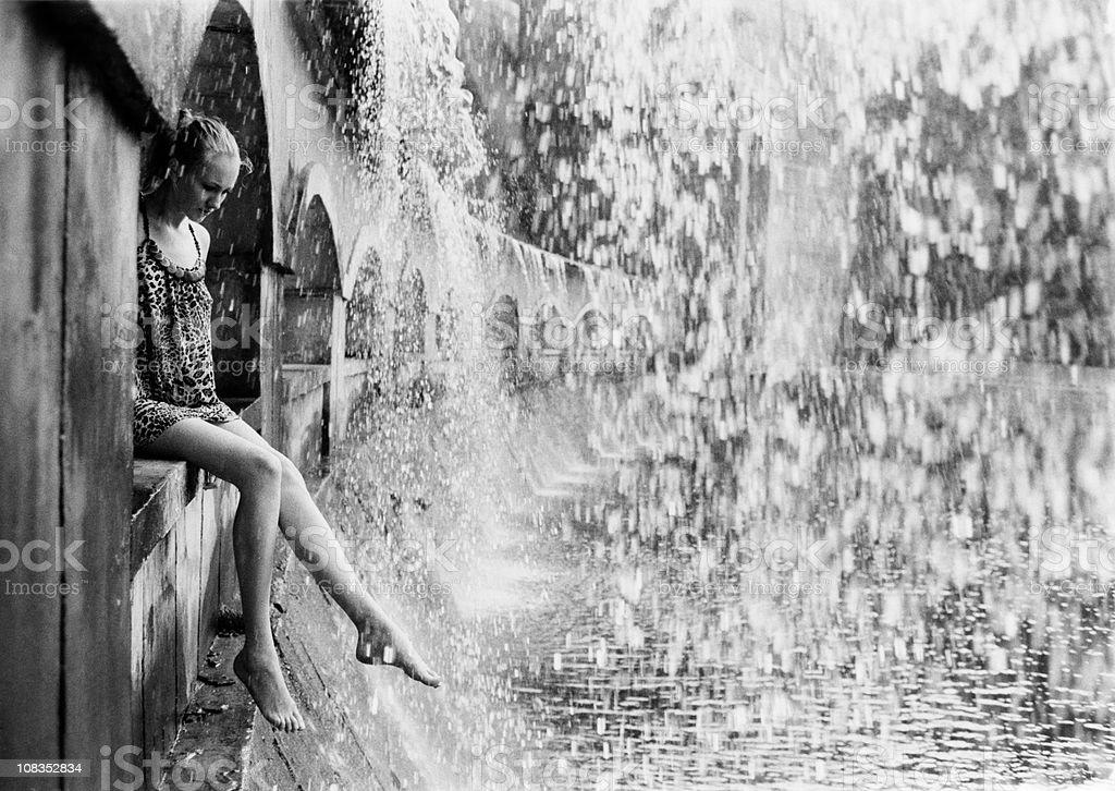 Woman under waterfall royalty-free stock photo