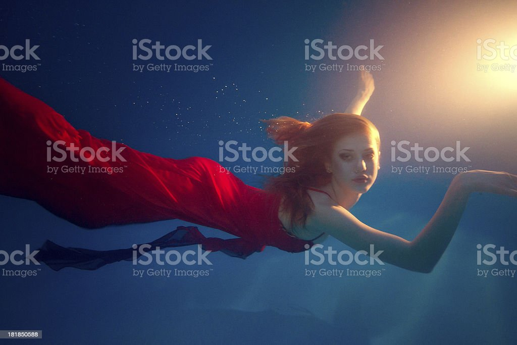 woman underwater stock photo