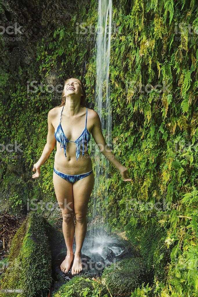 Woman underwaterfall in Hawaii royalty-free stock photo