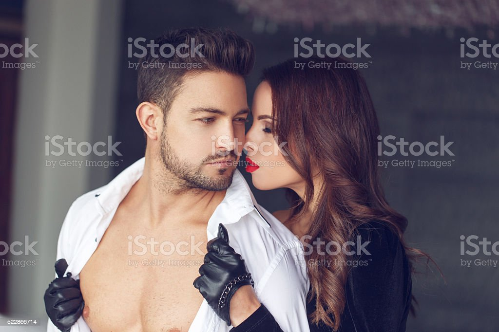 Woman undress young lover indoor stock photo