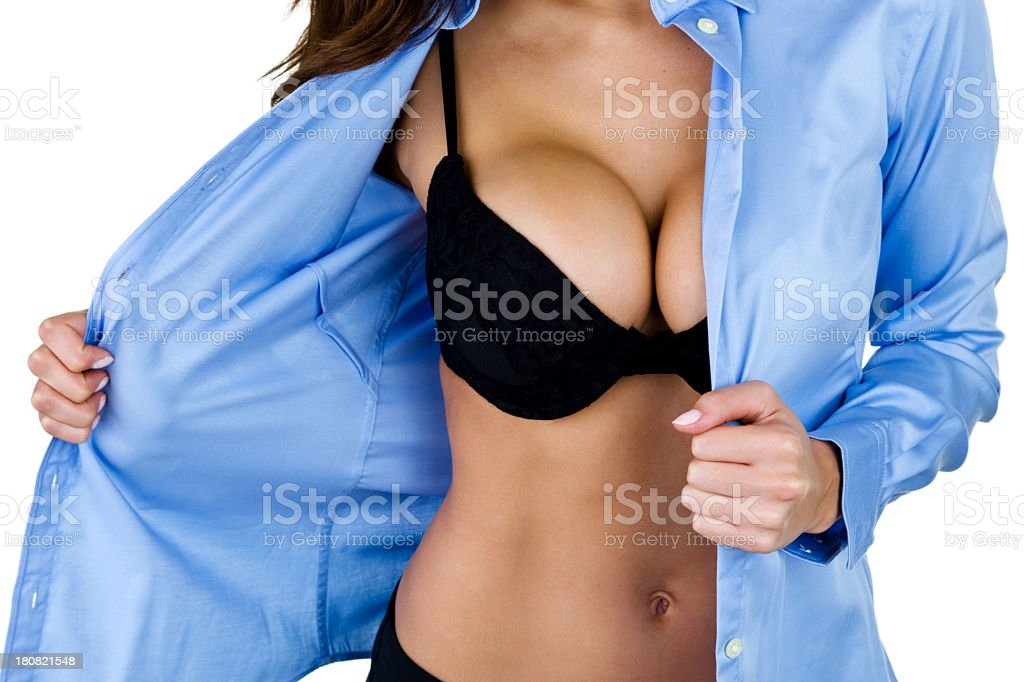 Woman undressing stock photo