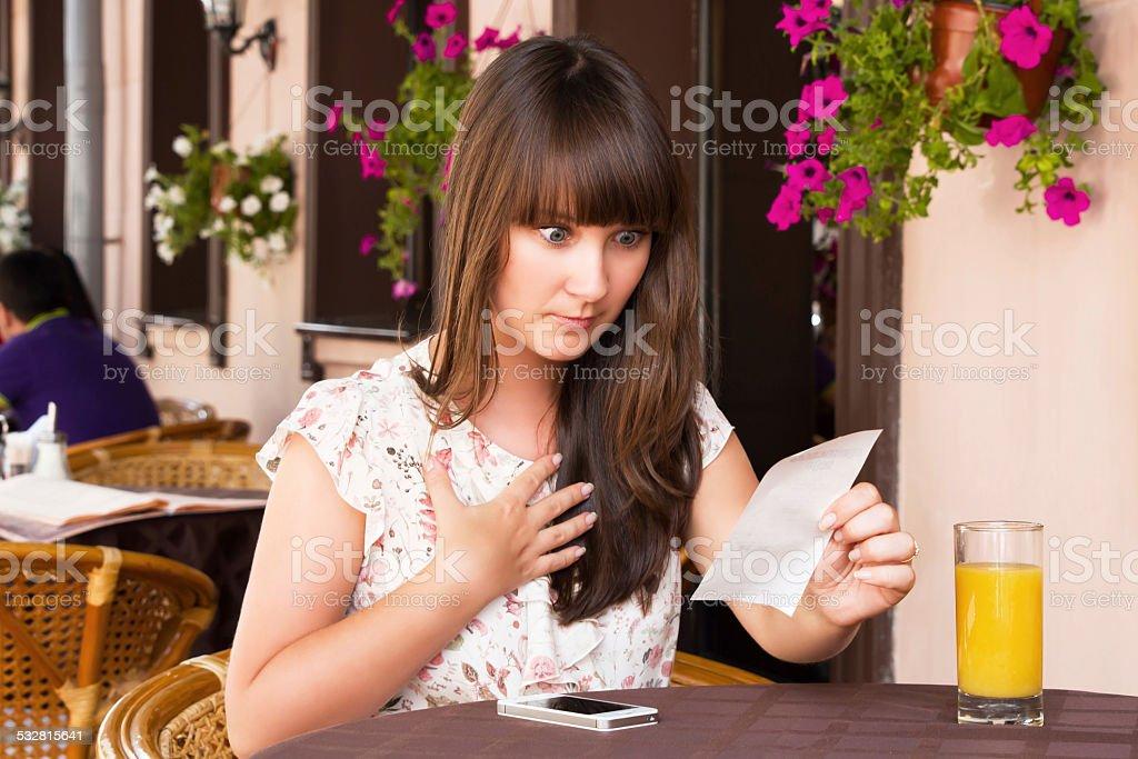Woman unhappy amount of the invoice stock photo