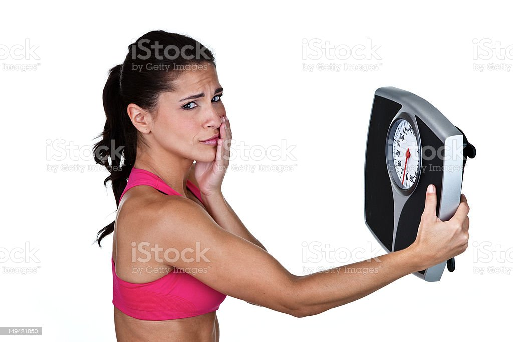 Woman unhappy with weight loss results royalty-free stock photo