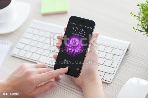 istock Woman unlock iPhone 6 Space Gray over the table 466147382