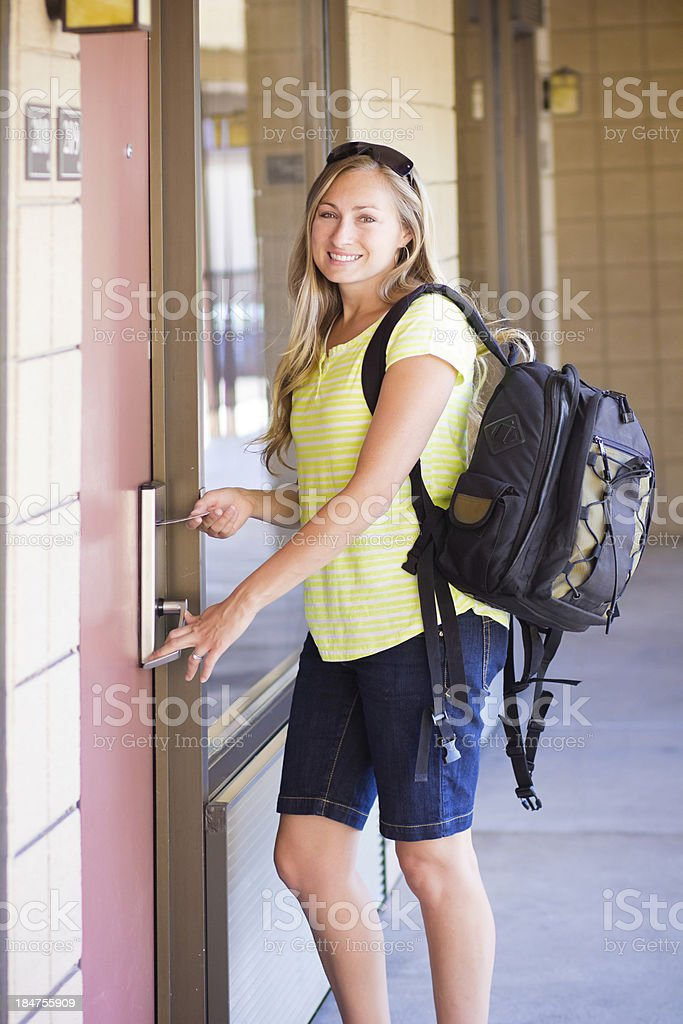 Woman unlocking her Hotel Room Door royalty-free stock photo