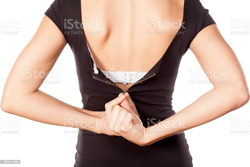 woman unzipping her dress stock photo