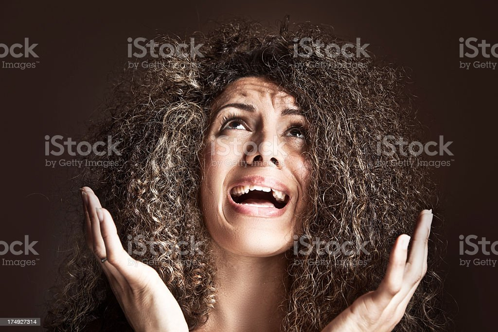 A woman upset with her frizzy hair stock photo