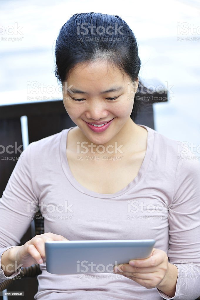 woman use digital tablet in outdoor cafe royalty-free stock photo
