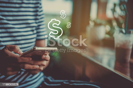 Woman use gadget mobile phone earn money online with dollar icon pop up .Business technology on smartphone concept.