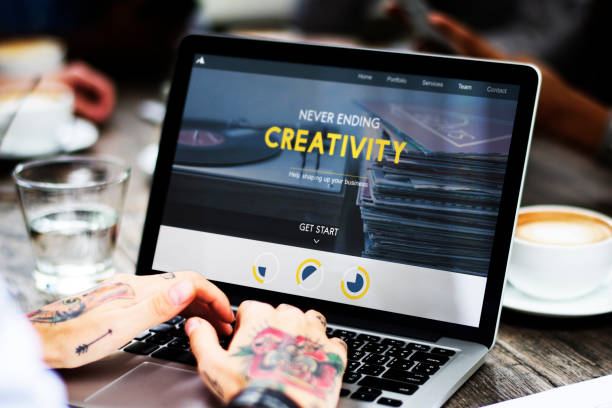 woman use laptop work cafe - tattoo ideen stock-fotos und bilder
