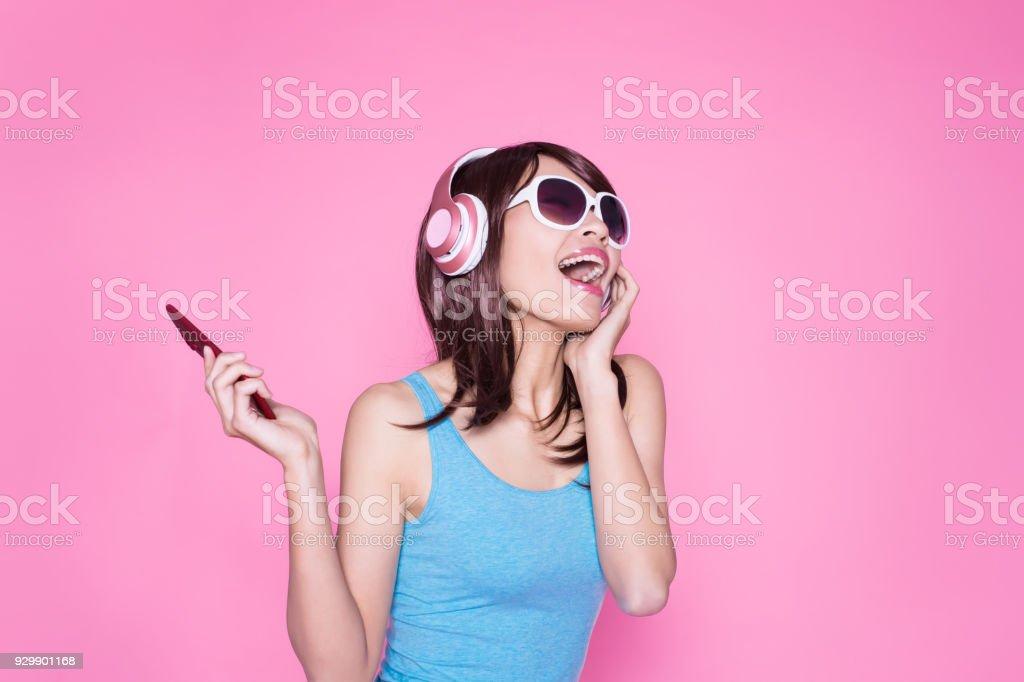 woman use phone listen music royalty-free stock photo