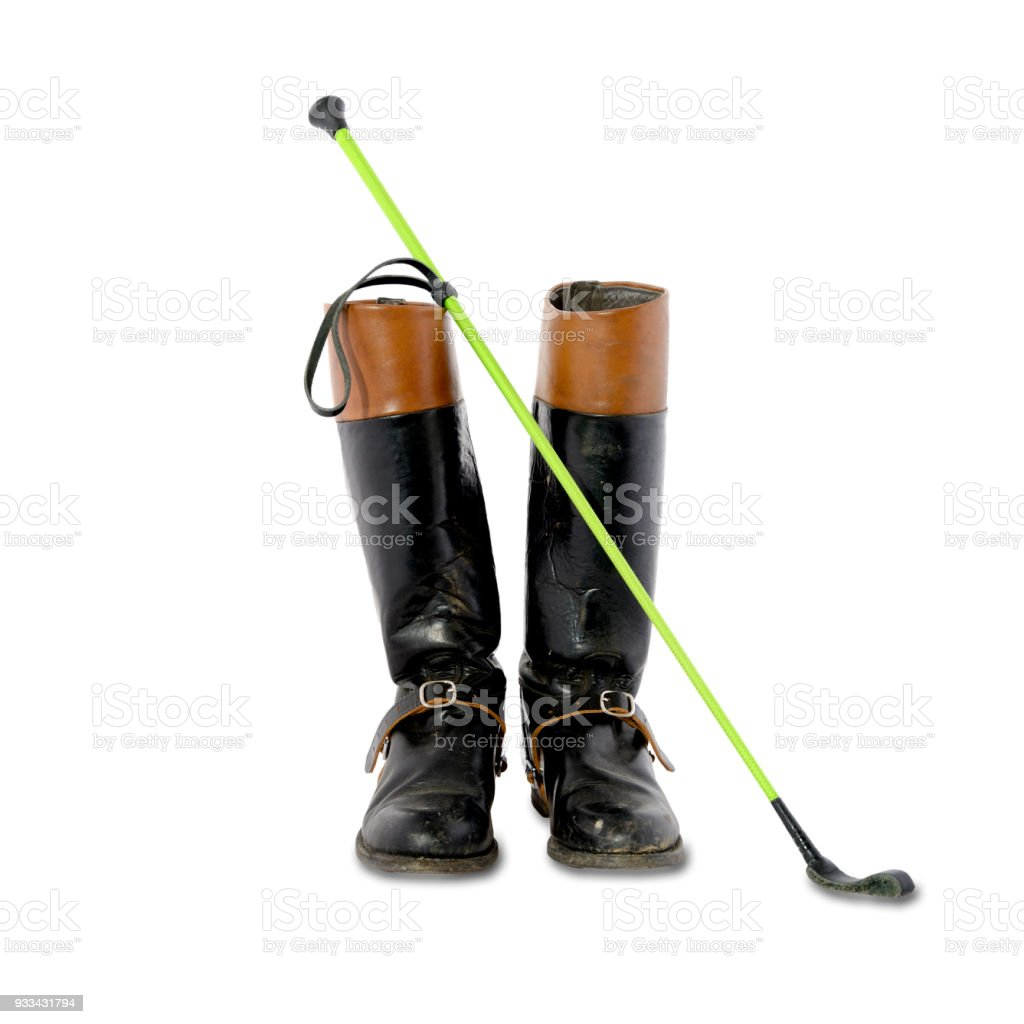 Woman used riding boots with spurs and riding crop stock photo