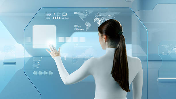 Woman uses a futuristic touchscreen interface stock photo